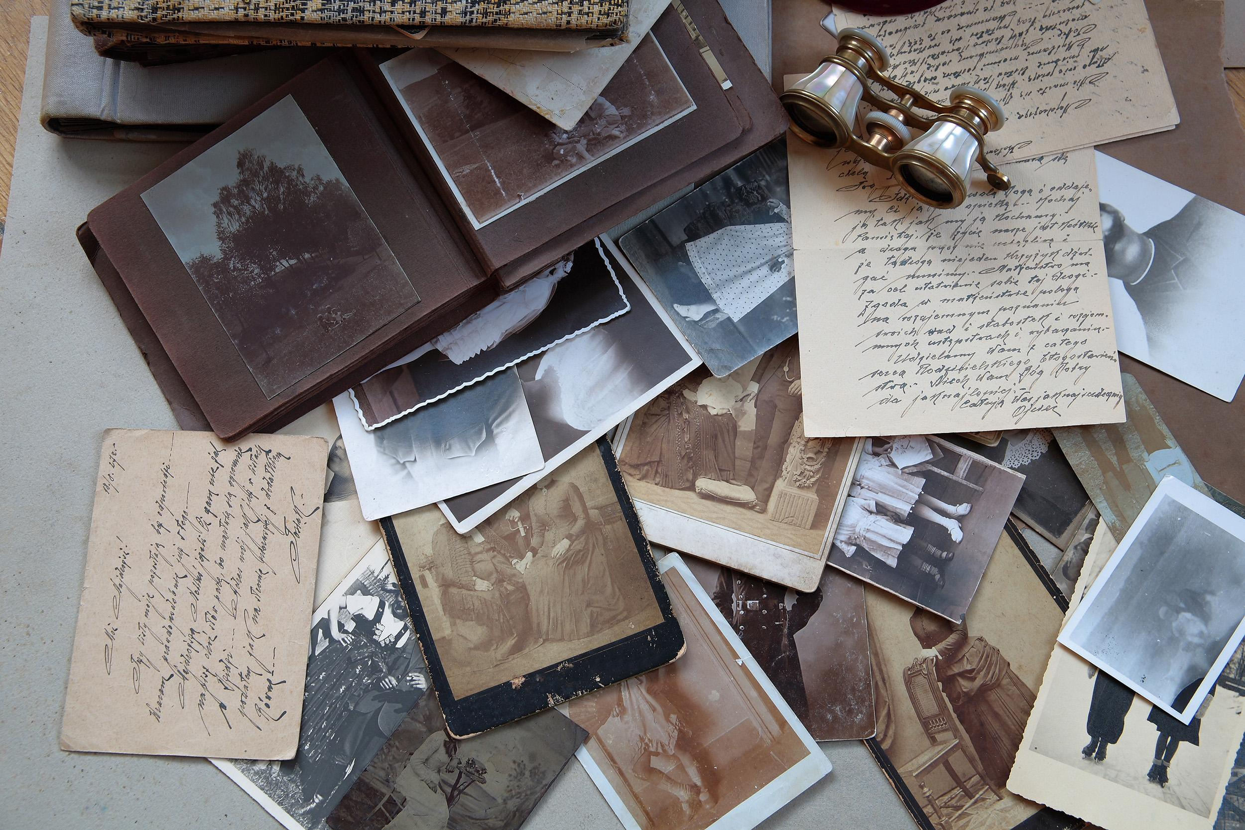 A collection of precious mementos such as photo albums, birthday cards, and framed pictures
