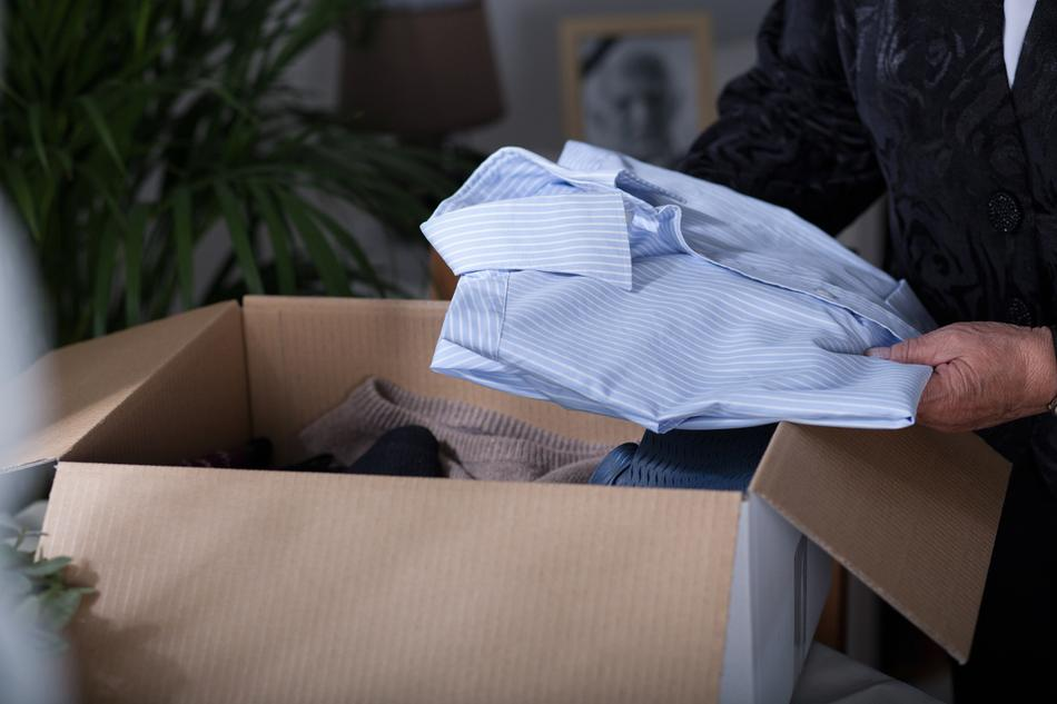 A photo showing clothing to be packed for shipping.