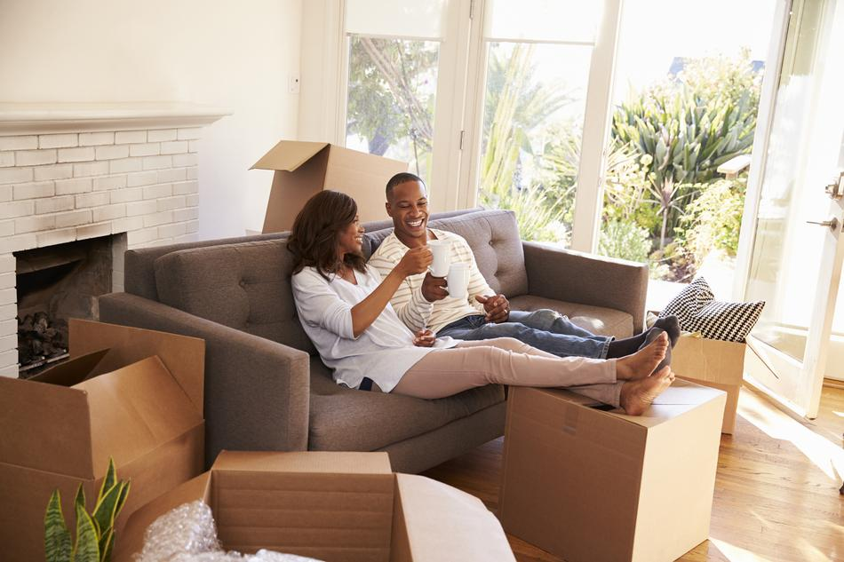 A photo of a couple in their new home after a stress free move.