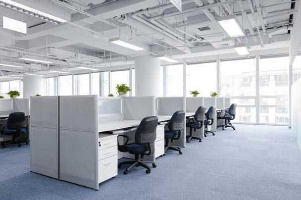 A small office containg cubicles and office furniture that require our overseas shipping services.