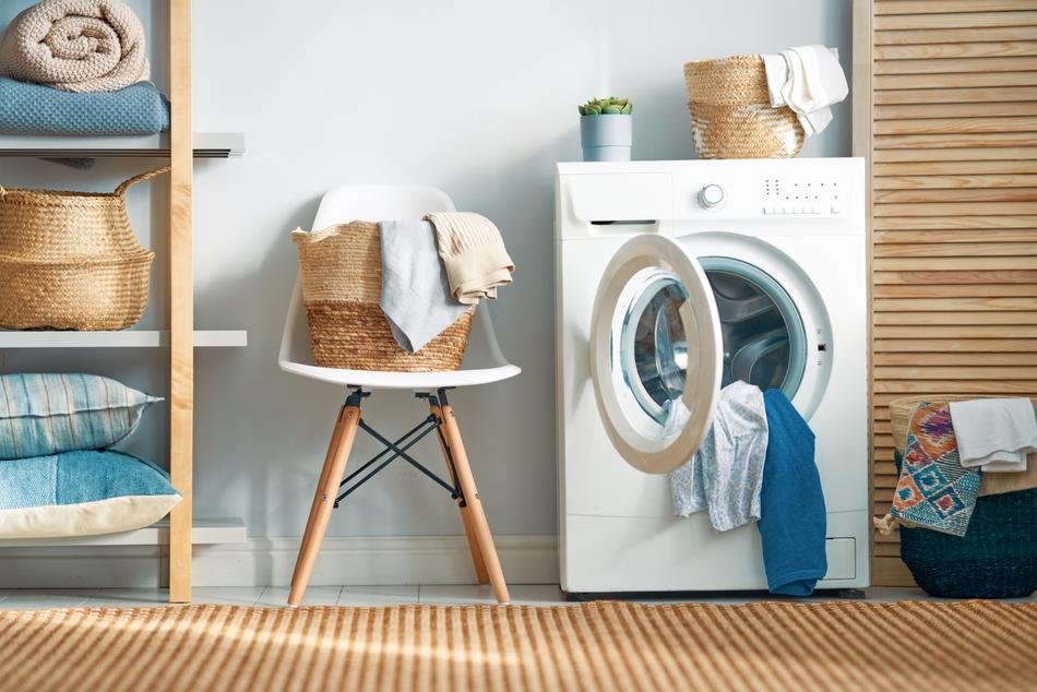 A laundry room with items that need to be packed and shipped.