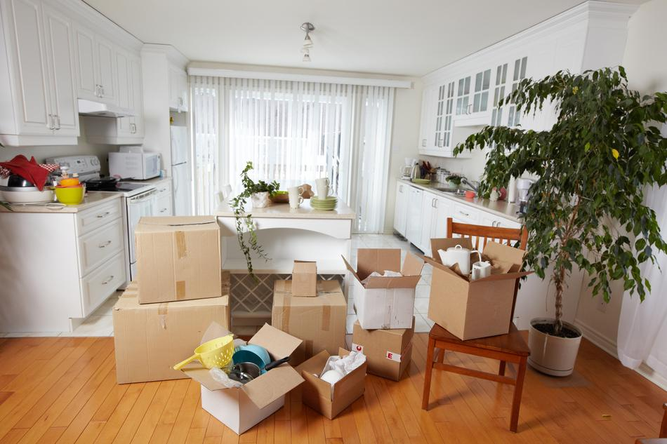 Shipping boxes filled with dishes, appliances, and furniure needing to be shipped.